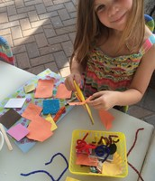 Skylar fills her collage with shapes and string
