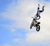 guy doing a flip on dirt bike