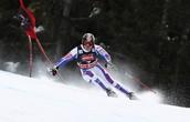 Olympian sliding around a flag
