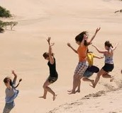 Kids Jumping down hills at Jockey's Ridge