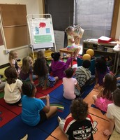 Lily reading to the class