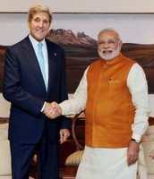 Prime Minister of India shakes hands with Secretary of State John Kerry