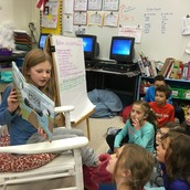 Cassidy reading as the Student of the Week