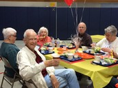 Senior guests enjoy lunch at Brewster