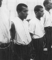 Romani (Gypsy) prisoners line up for roll call in the Dachau concentration camp. Germany, June 20, 1938.