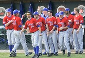The University of Kansas Baseball players go out before the national anthem