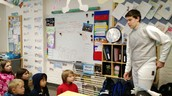 Leo shares a poem with Timothy House students