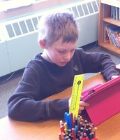 A student practicing his math facts!
