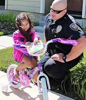 police officer helping little kid