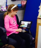 Elizabeth traded in Tiger Tickets to read to her sister's class!
