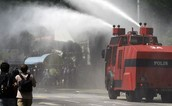 Fire fighters using water to save people's lives.