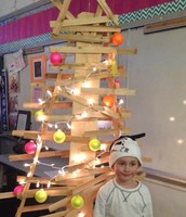 Carter cant heklp but pose with NEON ornaments!