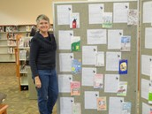 Ms. Dunsmore with Our Display at the Library