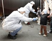 People Checking for Radiation On Children