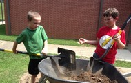 I didn't know filling a wheelbarrow with dirt could be so much fun!