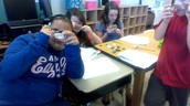 Observing mineral properties with hand lenses.
