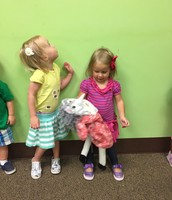 """Addie poses with the """"Old Lady Who Swallowed a Fly""""- it was actually a little disturbing to the two year olds ( her eating all those animals and then exploding :-)"""