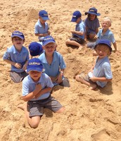 Last Thursday we went to the beach to build sandcastles and play beach cricket..