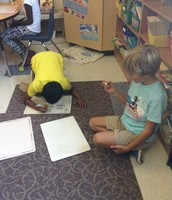 Hudson and Vishruth testing each other on addition