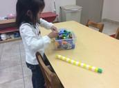 Olivia working with math manipulatives!