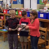Students with snake during Creature Teacher