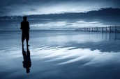 a men reflected in the water