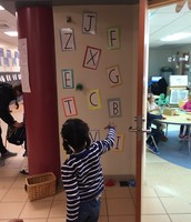 Practicing Gross MOtor skills and letters