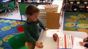 Mason measuring the height of his apple!