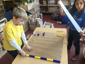 """Using blocks and creating """"blueprints"""" or strips of paper to record all the measurements"""