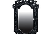 In the first part of the story there is a scene in which the daughter sees herself in the mirror. What does she see? What thematic significance could this scene have? How does it relate to the title?