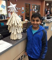 Krish created this upcycled Christmas tree from discarded library book pages.