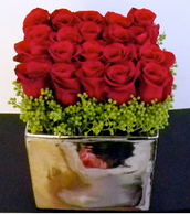 Modern, square arrangements are common now and roses are the perfect flowers to fill them.