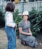 Ms. Maudie speaking to a child