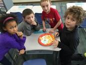 Karissa, Tristan, Dylan, & Jackson finding banana seeds