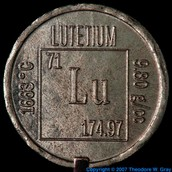 A Lutetium coin with its symbol engraved