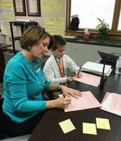 Principal Tucker and Principal Fickling signing pink forms!