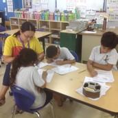Mrs. Mariko Helping Students