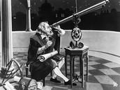 Galileo on his telescope