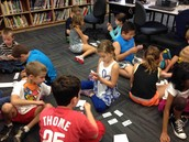 Third graders playing with Genre Sorting Cards