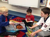 Daire, Max, and Timmy reading