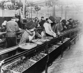 Workers in the factory working away at the parts