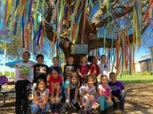 Ms. Simon's Panthers posing in front of the Positivitree!