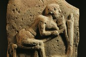 Babylonian plaque featuring a working man