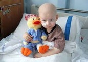 This is a leukemia patient with his stuffed animal.
