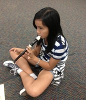 Earning her yellow belt in music.