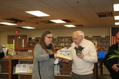 Mrs. Koenig awarding Mr. King: Support Staff of the Year