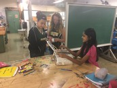 Students making a solar oven.
