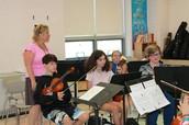 Mrs. Vitello instructing the Orchestra