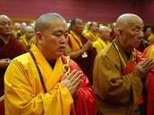 Chinese Monks praying.