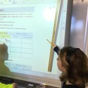 Lauren measuring the smartboard